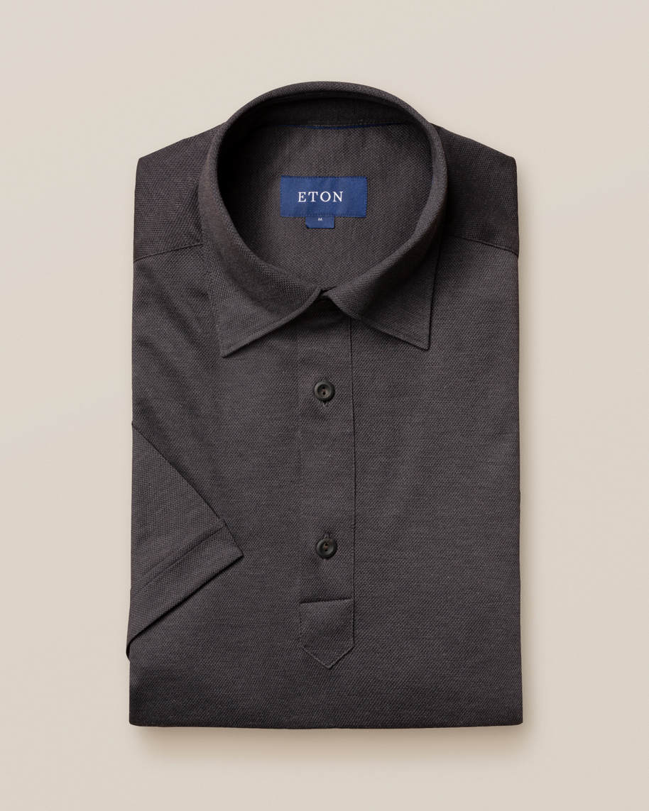 Dark grey polo shirt - short sleeved - image 1