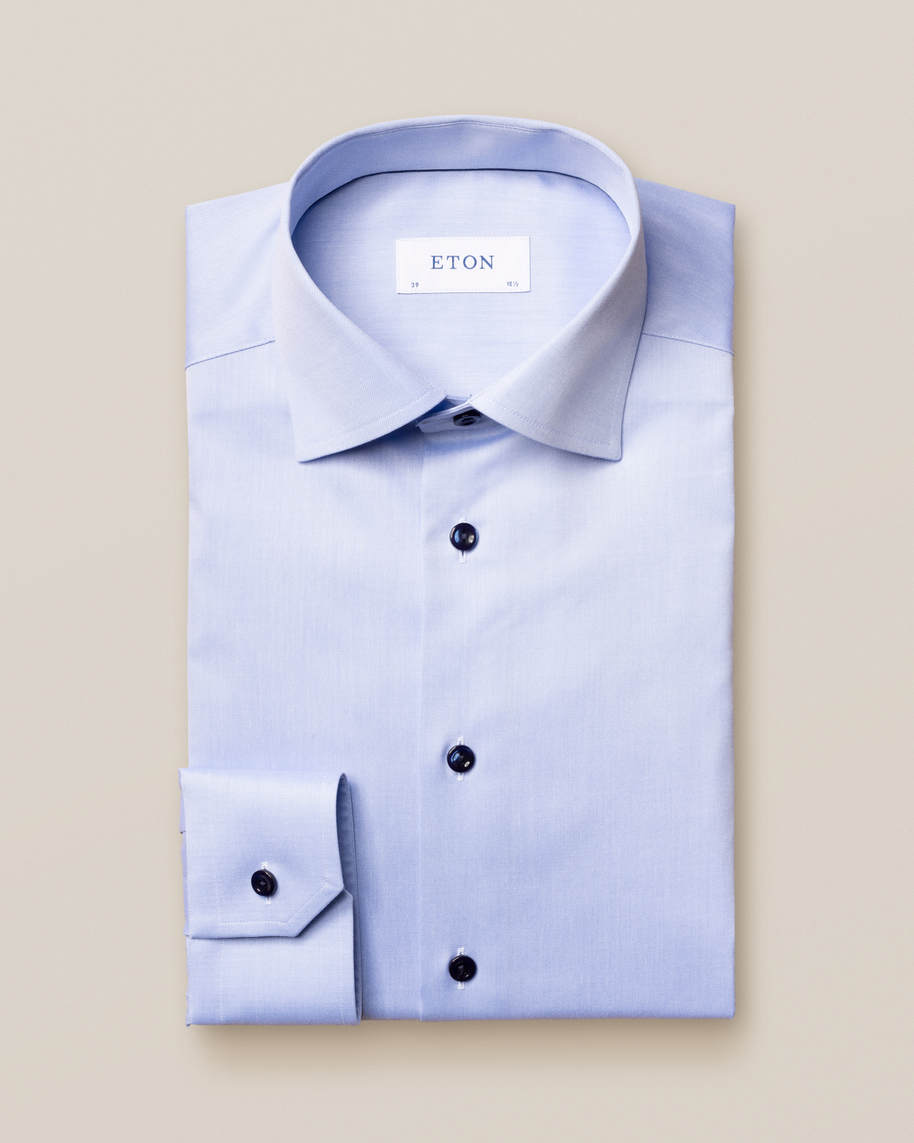 Blue twill shirt with navy details